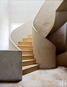 A staircase of lime mortar and Russian white pine | archdigest.com