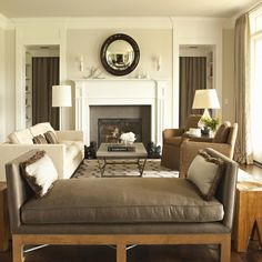 """The wall color is Farrow & Ball #201 (Shaded White). It is a very soft grey. The mantle/trim is Benjamin Moore's Swiss Coffee in Semi Gloss..."