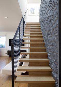 Cool staircase railing, wall and stairs.