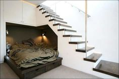 Nicer version if Harry potter... I would love having my bed in a little cubby under the stairs