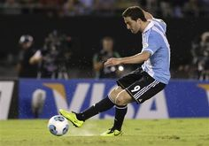 Argentina's Gonzalo Higuain shoots to score against Venezuela during a World Cup 2014 qualifying soccer match in Buenos Aires, Argentina,  Friday, March 22, 2013