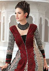 Attract all attentions with this embroidered suit. The dazzling light cream and black faux georgette churidar suit have amazing embroidery patch work is done with resham and zari work. Beautiful embroidery work on kameez is stunning. The entire ensemble makes an excellent wear. Contrasting red santoon churidar and shaded chiffon dupatta is available with this suit. Slight Color variations are possible due to differing screen and photograph resolutions.