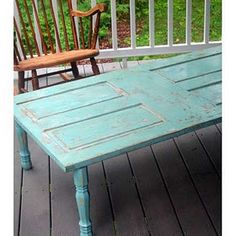Love the color and re-purposing of door into coffee table