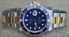 SOLD - Rolex Submariner 16613 18k Gold Blue Dial and Bezel, Gold and Steel Oyster, 2 Year Rolex Issued Warranty, with Box and more. $7000      704-277-4060