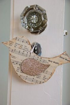 I love these birdie ornaments and they will be easy enough for the girls to make with me! Wouldn't these be pretty tied to gifts, too? And you could do them with all kinds of coordinating papers, not just music notes. We will be making the music note birds for our piano teacher though! :)