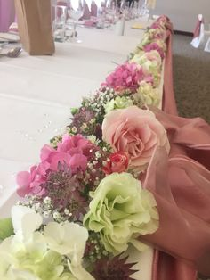 Top table flowers placed lisanthus roses gypsophilas hydrangea