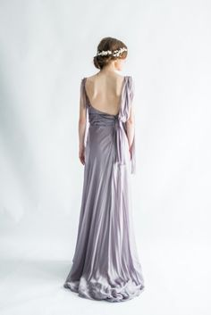 - Overview - Fabric/Care - Shipping - DESCRIPTION: Alluring Alberta Ferretti gown in a luscious lavender shade featuring pleated waist, draped silk ribbon on shoulders, and flowing skirt. CONDITION: E
