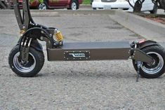 This WePed GT with its machined aluminum construction and carbon fiber accents, is the best-built electric scooter we've ever tested. Thunder Vs, Kart Racing, Street Performance, Heavy Rubber, E Scooter, Best Build, Drum Brake, Electric Scooter, Mtb