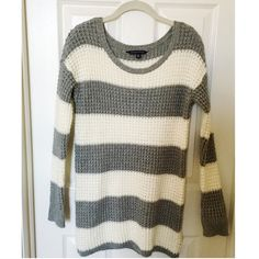 American Eagle Sweater Scrunches up or you can wear it anyway you want! Very versatile and cozy:) I have never worn or washed it before. Ask me if you have any questions! American Eagle Outfitters Sweaters Crew & Scoop Necks