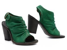 Made in Italy. Oh, mama! Sexy and sultry, Fiorentini + Baker's Floss is one mean 'n' green rockin' heel! Constructed from sinfully soft leather in the juiciest color—amped up further by cream topstitching—this peep toe sizzles with a sexy ruched seam running up its center!