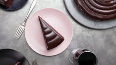 Recipe with video instructions: Make an already rich chocolate cake made with red wine even richer by topping it with a dark chocolate ganache. Ingredients: For the cake:, 1/2 cup butter, softened at room temperature, 3/4 cup brown sugar, 1/2 cup sugar, 2 large eggs, at room temperature, 1 teaspoon vanilla, 1 cup red wine, 1 1/2 cups all-purpose flour, sifted, 3/4 cup dark cocoa powder, sifted, 1/2 teaspoon cinnamon, 1/2 teaspoon baking soda, 1 teaspoon baki...