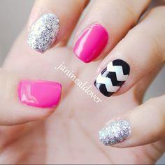 Glitter and chevron nails.
