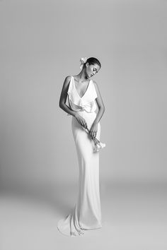 """""""ORCHID"""" is a unique wedding gown made of crepe with special flower-looking draping details at the front and back, a fitted skirt with a sweep-train, a diamond-look belt and an open-back and v-neck front. This dress is a part of the new Livne White 2018 bridal gown collection.  Available in selected stores worldwide. Save & Click for more information. #bride #weddingdresses #alonlivne #wedding #bridal #weddingdresses #weddingdress #livnewhite #weddingideas #weddinginspiration #customdress"""