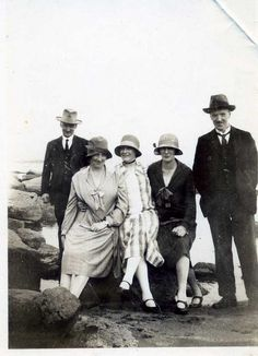 1920s -a group of very well dressed men and women