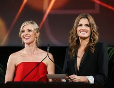 Actresses Amy Smart and Stana Katic speak onstage during the 25th Annual EMA Awards Presented By Toyota And Lexus at Warner Bros. Studios in Burbank, California on (October 24, 2015)