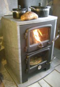 Fireplace and pizza oven in one! Soapstone Masonry Heaters and Massive Soapstone Wood Cook Stoves