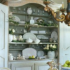 love the white stoneware and French cabinet