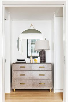 The dressing room runs the entire length of the building across the room from the master bath. With plenty of his-and-hers space, the walkway also features a statement dresser from Made Goods.
