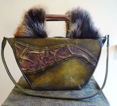 Leather handbag- circular shape/olive brown/beaver fur by gajakp on Etsy Leather Handbags, Fur, Shapes, Throw Pillows, Brown, Etsy, Leather Purses, Cushions, Decorative Pillows