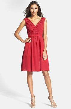 """Beautiful shirring shapes luxurious chiffon into a crisscrossed, V-neck bodice and whimsical A-line skirt on this effortlessly flattering dress nipped in at the waist by a smooth, tonal band.  41"""" length. Hidden back-zip closure. Draped, front-and-back V-neckline. Flowing, knee-length skirt. Lined. 100% polyester. Dry clean. By Jenny Yoo #valentine"""