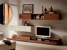 Natuzzi wall unit, I like the assymetrical placement of the wall units, I think this would work with black and white glossy units. I would prefer this without so much stuff on the wall units, maybe one or two carefully chosen items. Modular Cabinets, Bedroom Furniture Online, Modern Tv Wall Units, New House Plans, Luxury Living, Sweet Home, Furniture Design, Furniture Ideas, Living Spaces