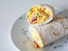 Breakfast Wrap with perfect scrambled eggs, bacon, ham and melty cheese. So delicious! Egg Wrap, Breakfast Wraps, Scrambled Eggs, Ham, Bacon, Cheese, Cooking, Food, Kitchen