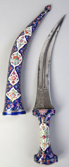 Persian jambiya dagger, 19th century enameled scabbard, the very fine damascus watered blade in good condition with chiseled decoration of fighting animals.