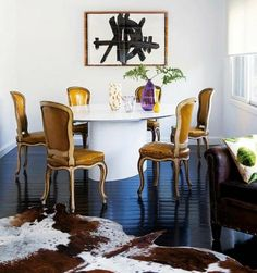 Mustard chairs against glossy black floors