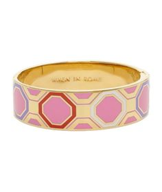 Kate Spade When in Rome Idiom Bangle Bold graphics have zing on this shiny gold-plated bangle with unexpected shades of pink, red, and purple.