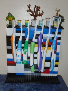 I needed something convenient for the 7 of us. I was initially thinking about a lego wall-mounted toothbrush holder, but my 10 y.o daughter came up with this, which works even better (no holes in the wall!).  Made of Mega Bloks. I guess it will probably get dirty quickly with the black and the bumps and holes, but cleaning with a brush should do it.
