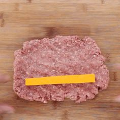 Then, season your ground meat for taste. Next, you want to split the meat into 5-6 palm sized balls. Flatten each ball out into a rectangle and place a cheese stick toward the bottom. Finally, roll it up to completely conceal the stick of cheese.   This Ultimate Burger Dog Will Slay Your Entire Life