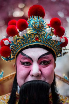 A performer wearing a traditional costume in China