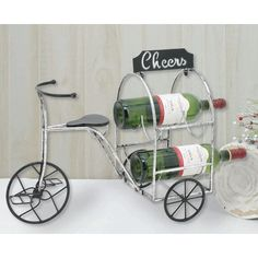 Decorative metal tricycle holds up to four bottles of wine. This lovely wine holder is perfect all year long. You can spruce it up with flowers in the springtime and add greenery, holly and even a Santa in the seat during Christmas time. Wine Bottle Holders, Tricycle, Christmas Time, Display, Canning, Decor, Floor Space, Billboard, Home Canning