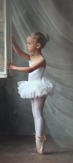 Russian child model Ksusha Tikhonova. Too young for pointe and not a skilled ballet photo, but i really like this picture