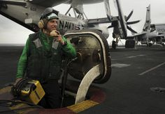 PACIFIC OCEAN (May 10, 2013) Aviation Boatswain's Mate (Equipment) Airman Robert Rahn relays instruction to raise and lower a jet blast deflector on the flight deck of the aircraft carrier USS Nimitz (CVN 68). Nimitz is deployed in the U.S. 7th Fleet area of operations. (U.S. Navy Photo by Mass Communication Specialist Seaman Kole E. Carpenter/Released)