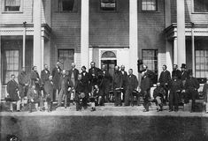 Photograph of John A. Macdonald, seated front row centre, and delegates from the legislatures of Canada, New Brunswick, Nova Scotia and Prince Edward Island at the Charlottetown Conference on Confederation, September 11, 1864