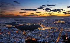 """Panoramic view of Athens from Lycabettus hill, after sunset. To the left is the Panathenaic stadium (""""Kallimarmaron""""), closer to the center of the photo, the National Park and the Parliament. On the right is the Acropolis & the Parthenon. Acropolis Greece, Athens Greece, Greece Trip, Athens City, Parthenon, Oh The Places You'll Go, Cool Pictures, Amazing Photos, Airplane View"""