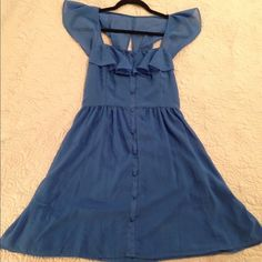 Vintage inspired blue dress Fun vintage inspired blue dress. There are little buttons up the front but they are cosmetic and you don't have to button it up. Almost cape sleeves, very light weight. Only worn once! Please comment if you have any questions. 25% off bundles! Dresses