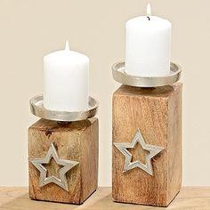 Kerzenleuchter Stern Diese schönen Kerzenständer aus Holz und Metall sind verziert mit einem Stern. Ob zusammen oder einzeln: Die Kerzenständer sind, vor allem in der Winterzeit, ein schönes Accessoires für ein jedes Zuhause.  Den Kerzenständer gibt es in den Höhen 13cm und 18cm.