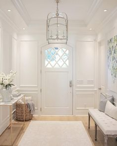 Foyer. White foyer with paneled walls, white oak floors and Circa Lighting Arched Top Lantern. #Foyer #Whitefoyer #paneledwalls #foyerpaneledwall #whiteoakfloors #CircaLightingArchedTopLantern