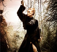All black statement this season with fluffy cloth and wool jacket design RIZMAN RUZAINI. Ola earrings add luxury.
