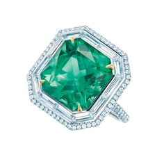 Tiffany  Co.'s Emerald Ring.  Boasting a playful mix of differently sized diamonds, this platinum and emerald ring sparkles and shimmers with green beauty.