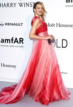 PETRA NEMCOVA offsets the candy sweetness of her ombré pink-and-red Georges Chakra Couture gown with a deep wine lip, burgundy clutch and spiky ruby Chopard danglers
