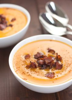 Creamy slow-cooker sweet potato soup topped with crunchy, salty-sweet maple bacon.