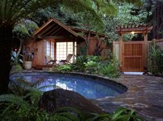 exteriors design landscape pool wood gate poolhouse roof trees plants nature natural rustic house stone chairs private