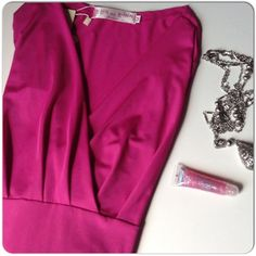 """NWT FUCHSIA LONG SLEEVE DRESS New with tags synthetic blend long sleeve dress with faux wrap bust & wide build in sash to hug the waist with the fit you want. Some pleating at the empire waist creates volume in the bottom half with a fit & flare away from the hips & tummy design. The color is fuchsia with a tiny bit of a purple shimmer hue but its very subtle. The sash is designed somewhat like an obi worn in Japan! The dress is unlined but not sheer. S bust 36"""", waist 30"""", M bust 38-40""""…"""