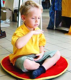 Young Falun Gong practitioner meditating