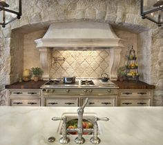 Awesome Mediterranean Kitchen Design In The Custom House: Marvelous Mediterranean Kitchen Design Showing The Exposed Stone Wall And Backsplash Around The Chimney With Modern Gas Stove ~ SFXit Design Kitchen Inspiration