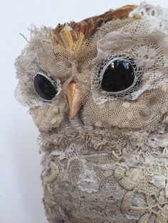 Lallie is a freestanding Owl sculpture, made using reclaimed textiles that are sewn and assembled over a wire armature. Her eyes are gilded and painted glass cabachons.Lallie's plumage is cut from hand dyed fabric and upholstry fabric in autumnul colours, and her tummy is covered with antique handmade lace.  Her wings are a woven upholstry fabric and crocheted lace. She has talons cut from mother of pearl buttons.My sculptures are not designed or made as toys, they are n...