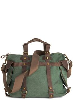 In the Event of Adventure Bag in Moss. You make casual errands look completely chic, just by holding the brown leather handles of this green canvas bag by Jesslyn Blake effortlessly alongside your sheer white blouse and high-waisted shorts. #green #modcloth
